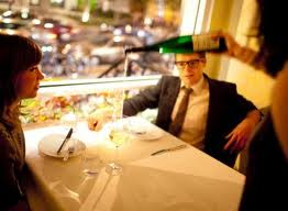 Sommelier pours wine for patrons at Komi Restaurant in Washington, D.C.