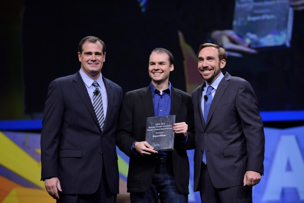 Chris Lopinto (center), president, ExpertFlyer, accepts Business Traveler People's Choice Innovation of the Year Award for Seat Alerts