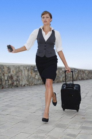businesswoman running with luggage